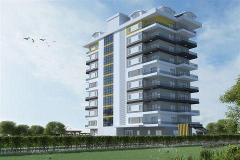 Nieuwe moderne appartementen op een beroemde locatie aan zee in Mahmutlar, Alanya